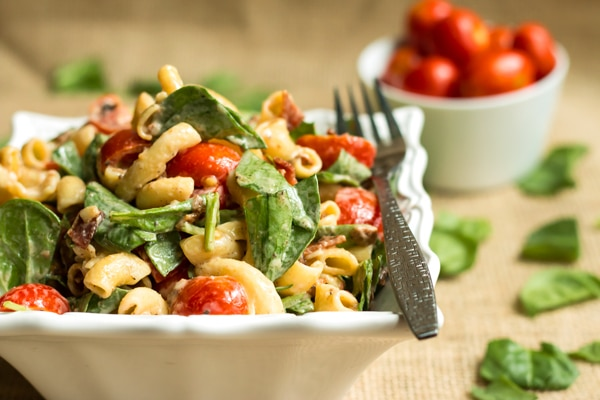 BLT Pasta Salad with Spinach   A quick and easy lunch or potluck dish recipe for pasta salad that is full of bacon, spinach and tomatoes.