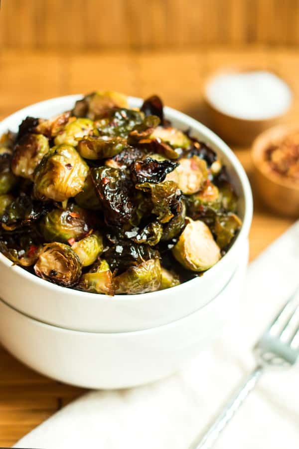 Honey Mustard Brussel Sprouts | These honey mustard brussel sprouts are full of a spicy and sweet combo that will have you craving more. Red pepper, honey and spicy red pepper come together to give these sprouts their flavor!