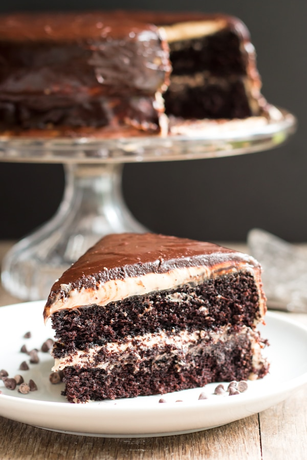 A gluten free dark chocolate cake recipe with a creamy peanut butter frosting and a rich chocolate ganache. The perfect cake recipe for any special occasion or birthday party!