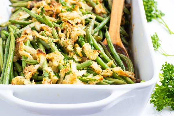 French fried onions on top of fresh green beans in a casserole dish.