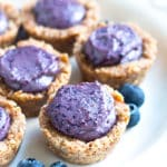 Gluten-free Healthy Blueberry Tarts on a white plate for a healthy treat.