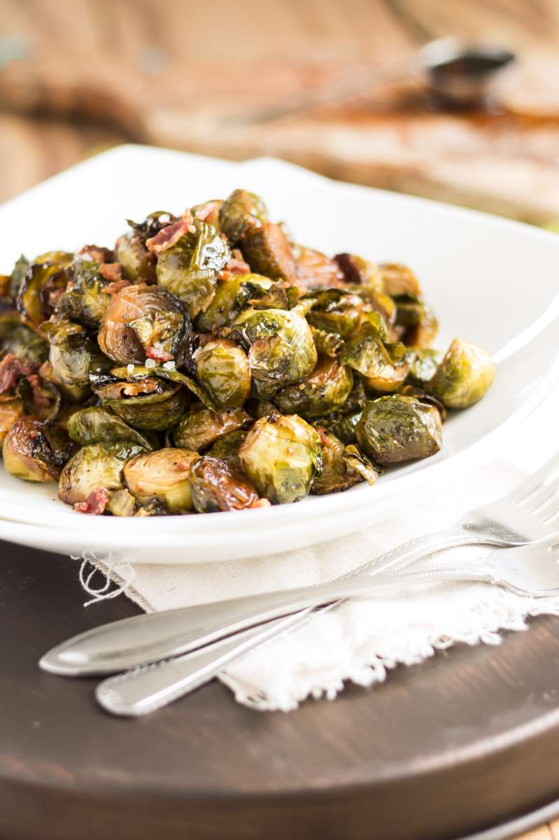 Maple Balsamic Bacon Brussel Sprouts | A gluten free side dish recipe for brussel sprouts covered in a maple balsamic glaze.
