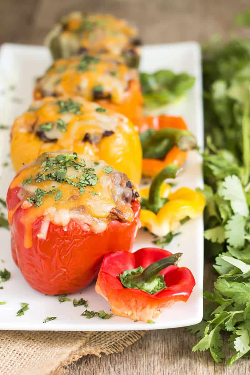 Chicken Relleno Stuffed Bell Peppers | A gluten free dinner recipe for stuffed bell peppers full of yummy relleno filling.