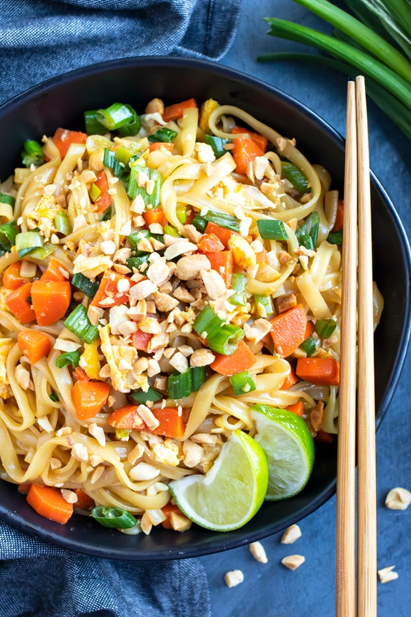 A large bowl full of a healthy and easy Pad Thai recipe with gluten-free soy sauce and peanuts.