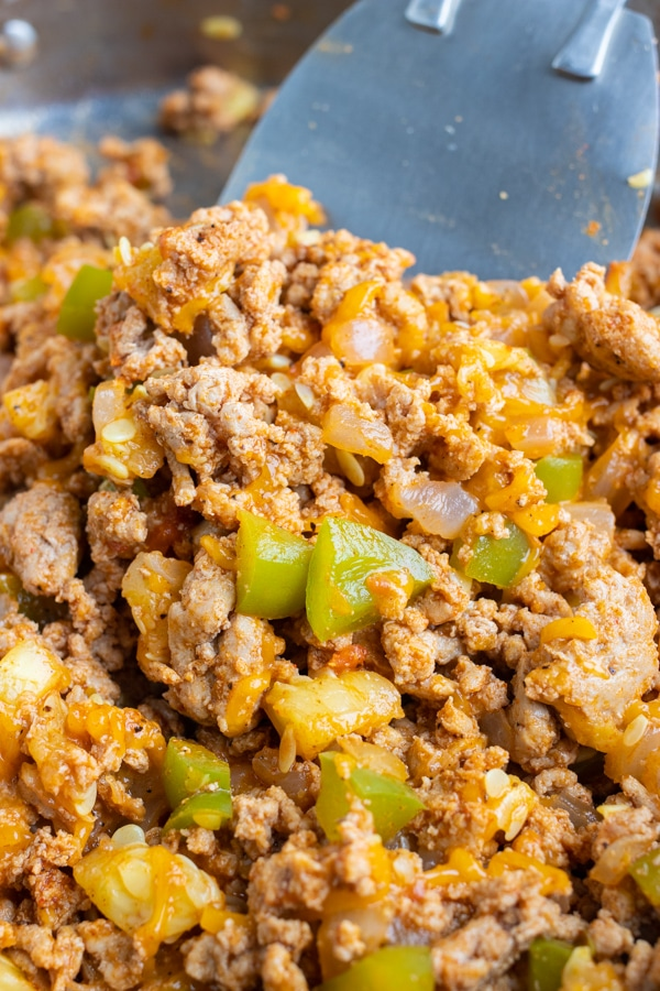 Ground meat taco filling with cheese and bell peppers.