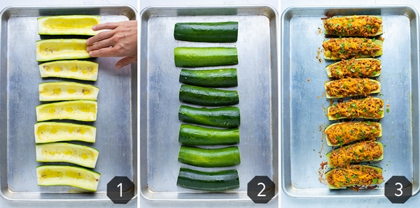 Zucchini that has been cut in half on a baking sheet showing how to make baked zucchini boats in the oven.