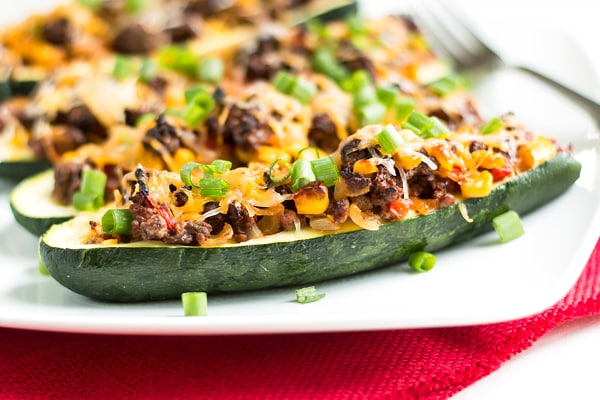 Zucchini Boat Tacos | A healthy, gluten free dinner recipe for zucchinis filled with a beef or turkey taco filling.
