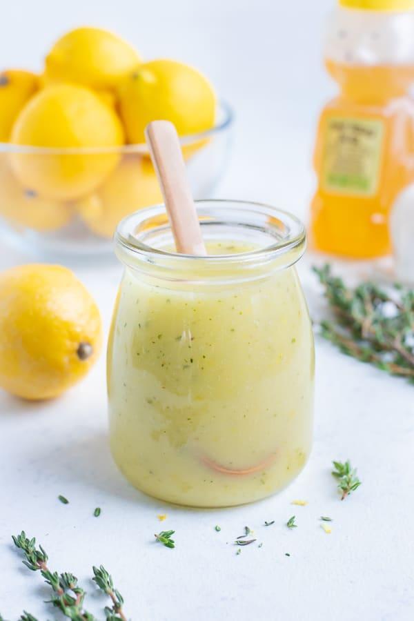 Lemon vinaigrette is served in a glass jar.
