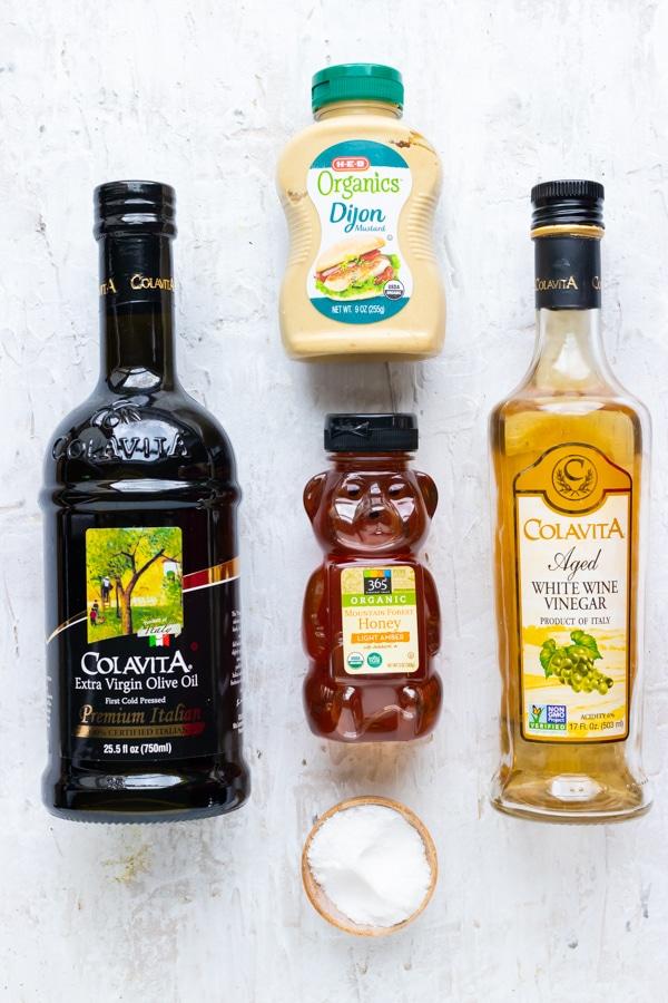 Honey, Dijon mustard, olive oil, vinegar, and salt as the ingredients for honey mustard.