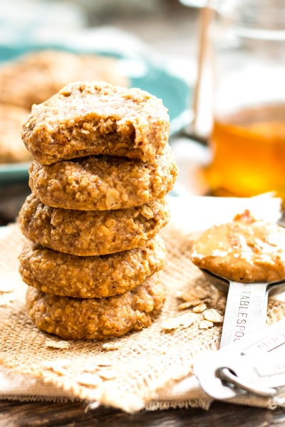 A stack of gluten-free almond butter cookies with oatmeal for a delicious snack.