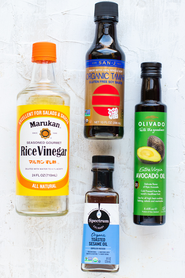 Rice wine vinegar, avocado oil, sesame oil, and gluten-free soy sauce as ingredients for a fried rice sauce.