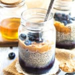 Two jars filled with Peanut Butter and Jelly Chia Pudding using chia seeds with spoons inside.