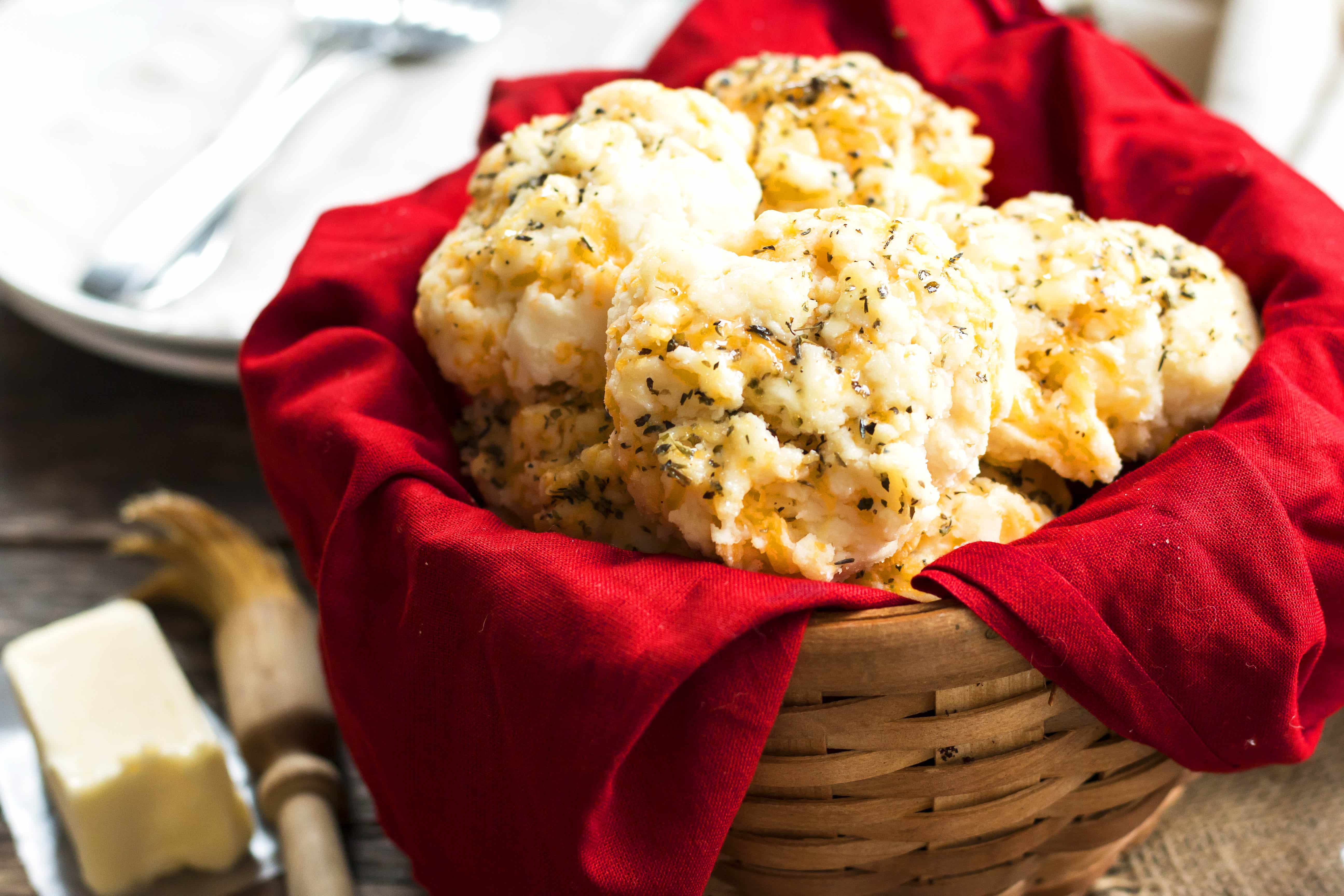A basket filled collection of biscuits using a Bisquick biscuit recipe similar to Red Lobster's for a delicious dinner.