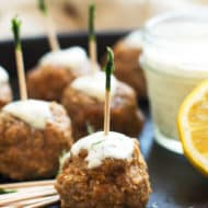 Mediterranean Turkey Meatballs with toothpicks placed in the middle for an easy appetizer.