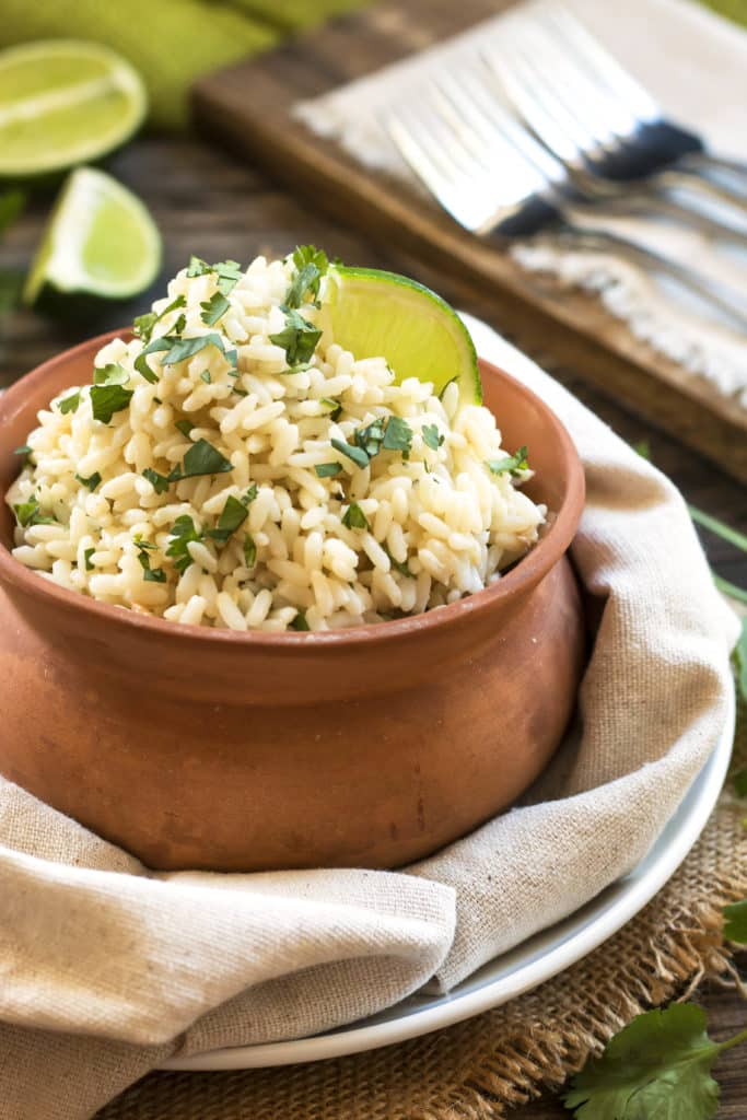 A bowl with gluten-free cilantro lime brown rice with coconut for an easy dinner.