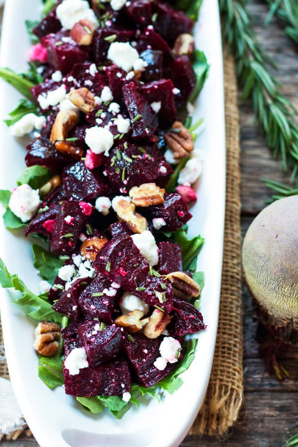 A tray filled with roasted beets, goat cheese, and pecans for an easy holiday side dish.