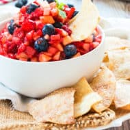 A plate with a bowl of Fruit Salsa and Sopapilla Chips for a healthy snack.