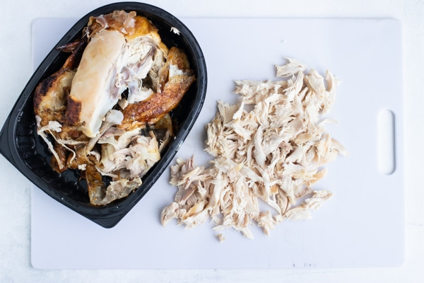 A rotisserie chicken that has been shredded.