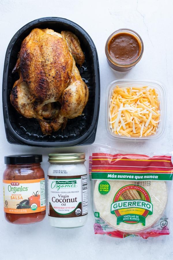 Chicken, cheese, corn tortillas, enchilada sauce as ingredients.