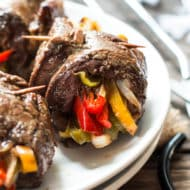 A healthy, gluten free dinner recipe for veggie and flank steak roll-ups. Cook these low-carb and Paleo steak roll-ups in a skillet or fire up the grill!