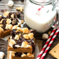 Peanut Butter S'mores Bars | A gluten free s'mores bar recipe with a peanut butter cookie crust, marshmallows and loads of chocolate chips!