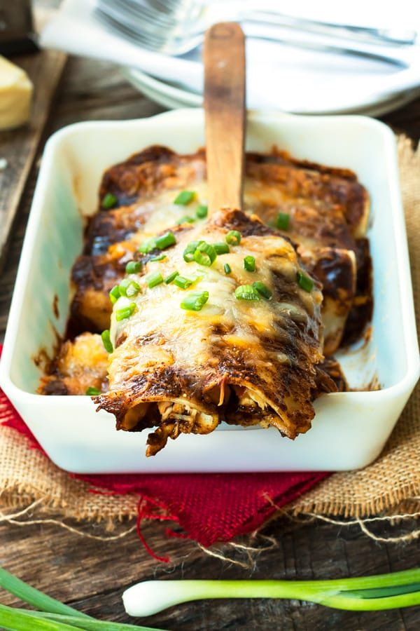 Rotisserie Chicken Enchiladas with Homemade Enchilada Sauce | A classic chicken and cheese enchiladas recipe with homemade, gluten free enchilada sauce. A great weeknight dinner recipe!