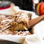 Gluten Free Apple Coffee Cake with Pecans | A gluten free coffee cake that is bursting with fresh apple flavor, cinnamon, and finished with a crumb topping and creamy glaze!