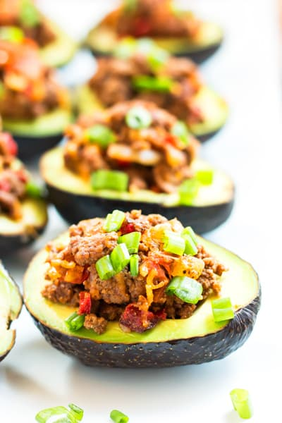 Beef Taco Stuffed Avocados | A healthy dinner recipe for avocados that are full of taco filling! It's gluten free, low-carb, and keto, too!