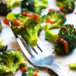 Gluten-free roasted broccoli made with Sriracha and honey on a fork for a healthy side dish.