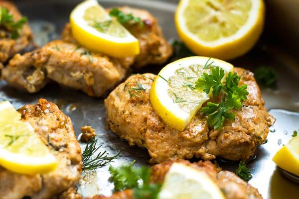 Lemon & Greek Yogurt Chicken | A healthy main dish dinner recipe for Greek yogurt chicken seasoned with lemon, parsley and dill.