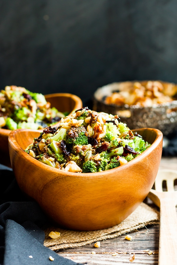Two bowls filled with a gluten-free broccoli salad recipe for a healthy dinner.