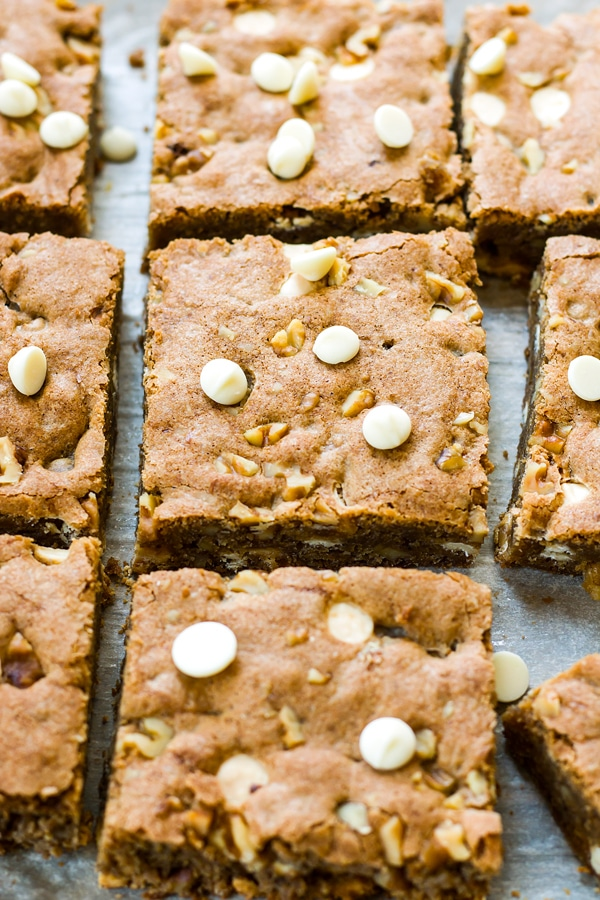 Maple & White Chocolate Gluten Free Blondies with Walnuts | A gluten free white chocolate blondie recipe that is full of walnuts and finished with a sweet maple caramel sauce.