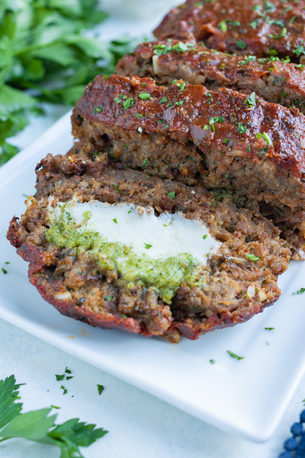 Meatloaf is stuffed with cheese and pesto.