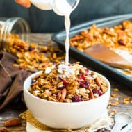 Pumpkin Spice Granola | Pumpkin granola that is sweetened with maple syrup and full of pecans, coconut, pumpkin seeds and hearty oats!
