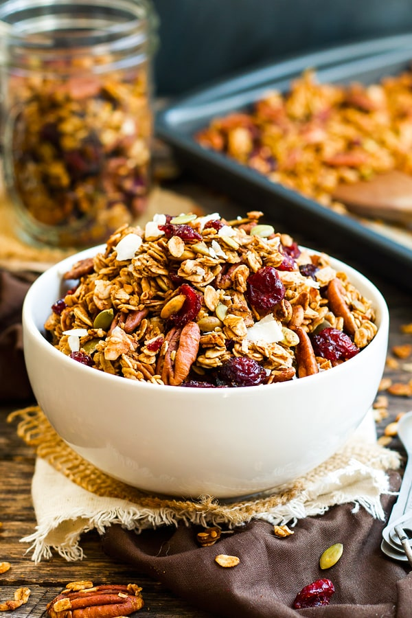 A bowl of maple granola with pecans and coconuts ready to eat for breakfast.