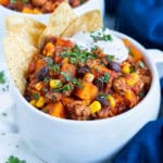 A bowl of Sweet Potato Chili is loaded with ground turkey, sweet potato, and seasonings for a fall meal!