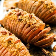 Hasselback Sweet Potatoes with Brown Sugar & Pecans   This gluten free and vegan side dish is perfect for a Thanksgiving, Christmas or holiday side dish.