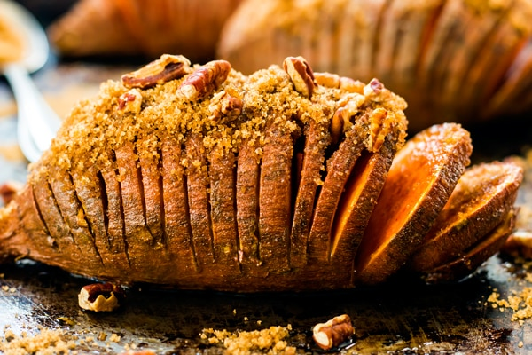 Hasselback Thanksgiving sweet potatoes with pecans ready for the holidays.
