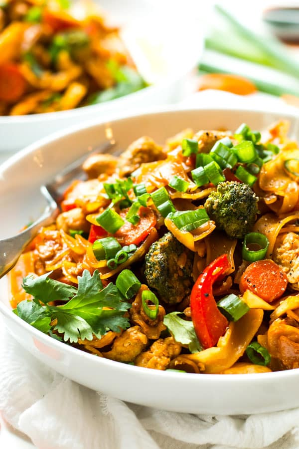 Easy Pad See Ew with Chicken makes a quick and easy weeknight dinner recipe. A traditional Thai noodle stir fry dinner recipe that is gluten free!