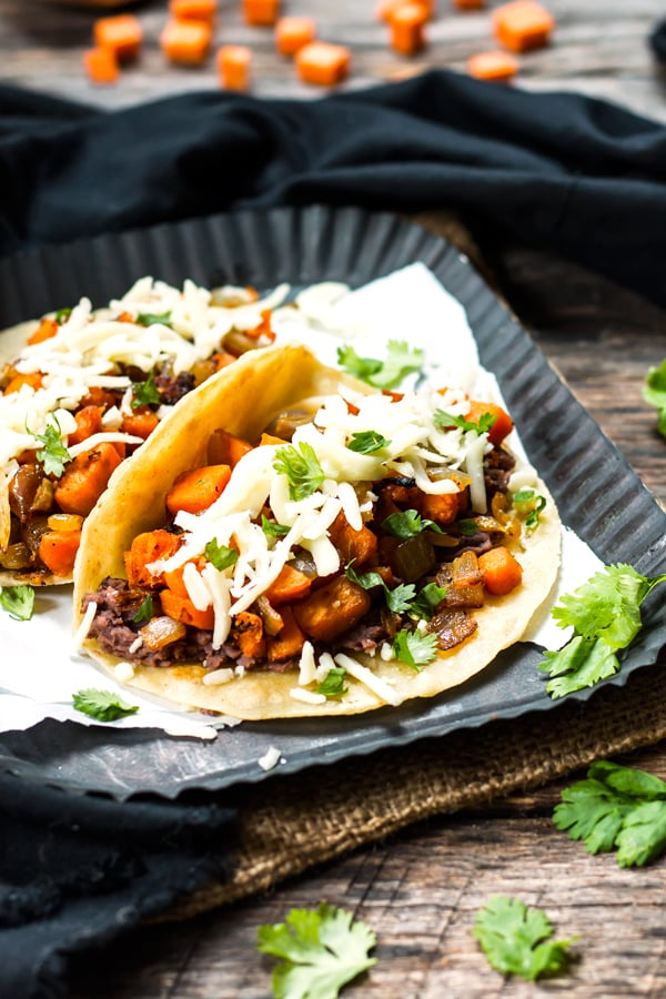 Gluten-free sweet potato tacos made with black beans for an easy lunch.