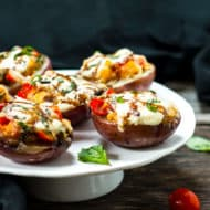 Caprese Stuffed Baked Potato Skins | New potatoes are stuffed with mozzarella, basil, tomatoes and drizzled with balsamic for the perfect party snack or appetizer!