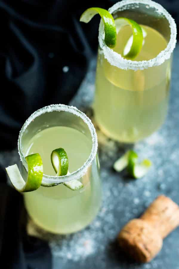 Two gluten-free champagne drinks filled with tequila for a delicious cocktail.
