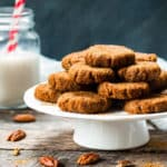 A collection of no-bake molasses cookie recipes on a cake plate ready to eat.