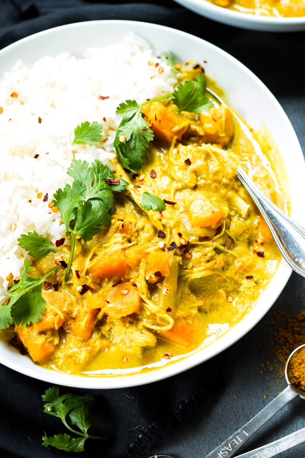 A bowl filled with gluten-free chicken curry with coconut milk ready to eat for dinner.