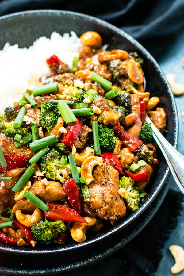 A bowl filled with a gluten-free cashew chicken recipe for a healthy dinner.
