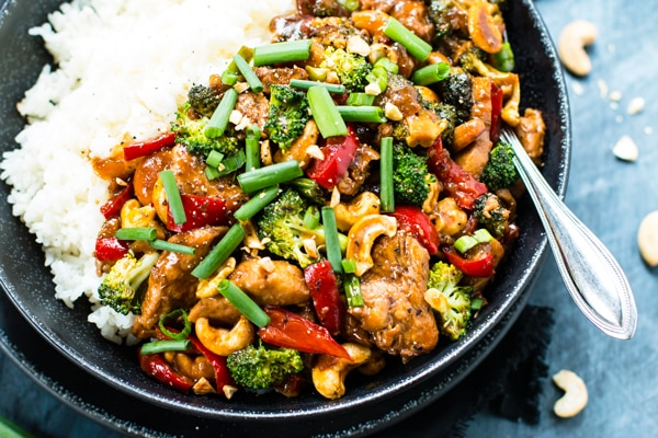 An overhead picture of chicken cashew stir-fry with rice for a healthy dinner.