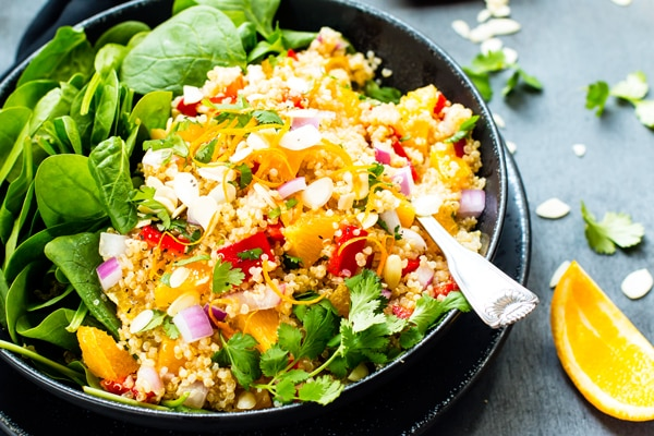 Vegan Quinoa Salad with Oranges & Spinach | It is so quick and simple to make, is full of heart-healthy nutrients, and makes a great vegan, vegetarian, gluten-free and dairy-free lunch or dinner quinoa salad recipe!