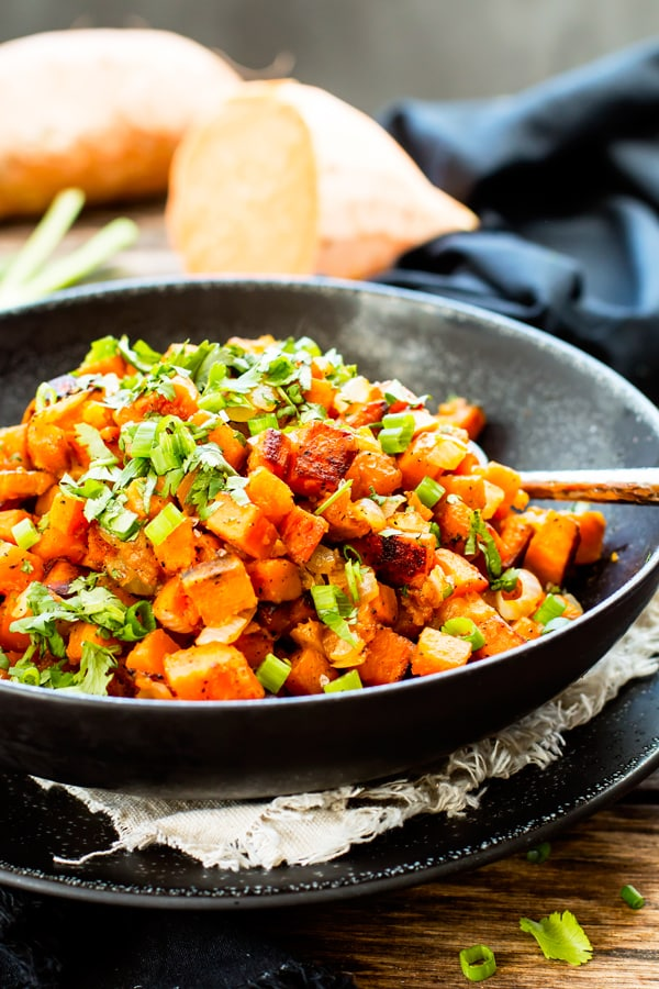 Skillet Sweet Potatoes with Cilantro in a black bowl ready for the holidays.