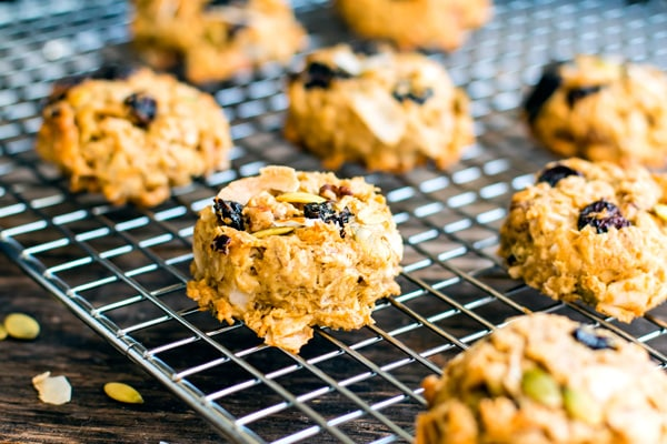 Gluten-free healthy oatmeal cookies using trail mix on a cooling rack.
