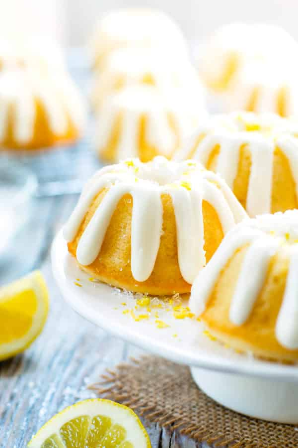 A collection of gluten-free Mini Lemon Bundt Cakes on a cake plate for dessert.